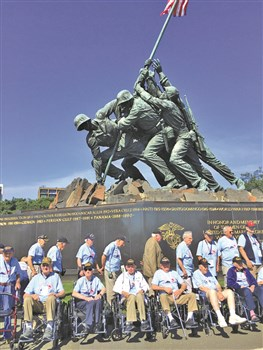 Earl Sherrow, center, was one of 43 Kentucky veterans who traveled to the nation's capital, where they got to see the U.S. Marines Memorial.