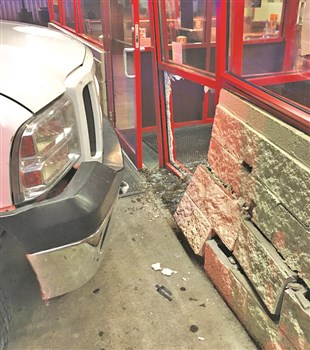 Justin Deaton, 18, of Salvisa, lost control of his truck, striking one youth and pinning another between a parked truck and the Huddle House Wall Sunday night.