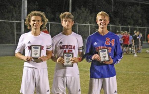 Mercer County seniors Nick McClain, left, Cody Shackelford, center, and Garrett Dean, right, were named to the 46th District All-Tournament Team following the Titans championship win.