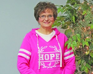 Nancy Simmons, pictured in her office, says she wants to give hope to those who are also battling cancer.