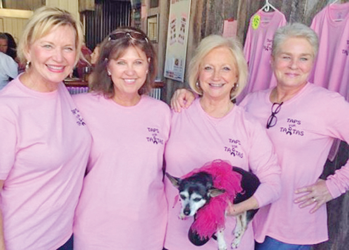 Susan Barrington, Vicky Moore, LouAnn Ison and Cala Coleman sporting their Taps for TaTas shirts at Lemons Mill Brewery last weekend.