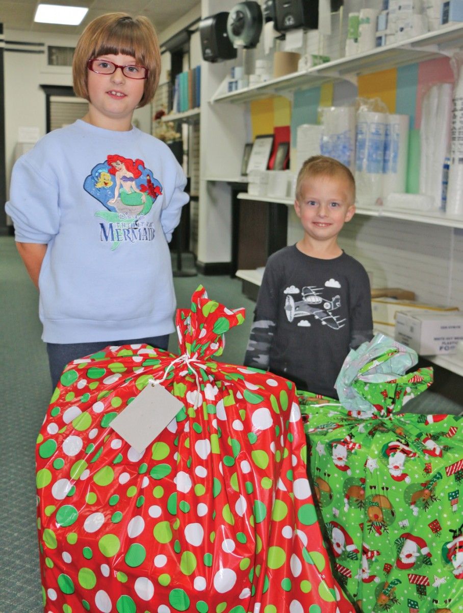 Macy Shirley, left, with her brother, Evan Shirley, donated gifts for the Love Tree at the Harrodsburg Herald office on Tuesday, Nov. 29. They are the children of Tim and Cassie Shirley.