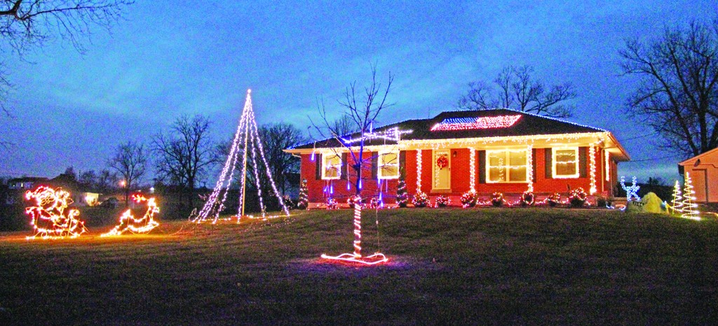 The Kidd Family said it takes about 12 hours and 10,000 lights to decorate their house for the holidays. The roof on their house, located on Perryville Road, features an American flag and a star.