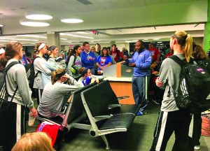 MCSH Athletic Director Donald Smith leads a devotional with the Lady Titans players, coaches and their families Sunday morning when they arrived at the airport before they learned of the flight complications.