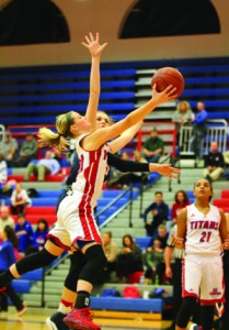 Emma Davis goes strong to the basket against Anderson's Alorra Sims in the Lady Titans' 83-60 victory Monday night.