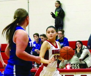 Julia Holton brings the ball up the court in the Lady Bulldogs 58-22 loss to Trinty Whitesville Friday, Dec. 30.