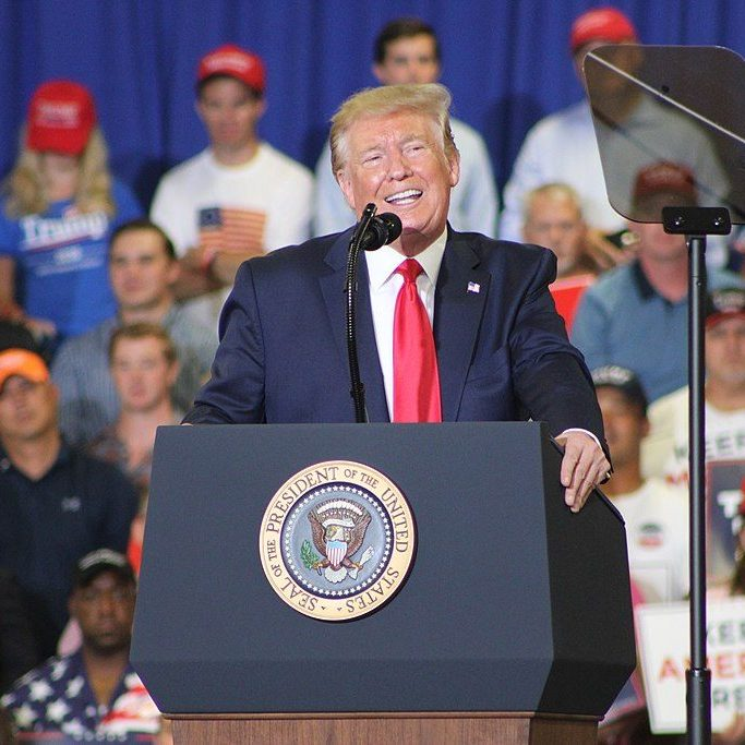 Pres. Donald Trump speaks at a rally in Fayetteville, North Carolina, in 2019. Image: Jackson A. Lanier, via Wikimedia Commons.