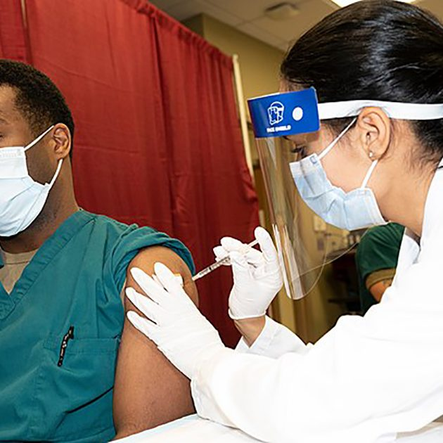Army Cpt. Isaiah Horton, a doctor at Walter Reed National Military Medical Center, receives a COVID-19 vaccination, Walter Reed National Military Medical Center, Bethesda, Md., Dec. 14, 2020. (DoD photo by Lisa Ferdinando)