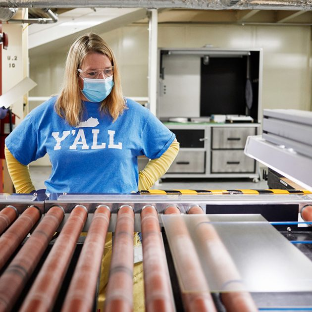 Photo Submitted Apple's $45 million award to Corning will expand manufacturing capacity in Harrodsburg and across the United States. Pictured is a worker within the Harrodsburg plant.