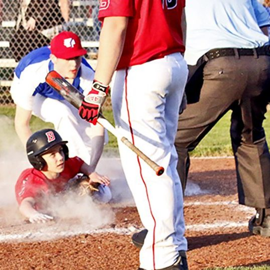 The Harrodsburg Herald/Doug Brown Landon Sexton beat the throw home in Burgin's heartbreaking loss to Eminence on Monday night. The umpire called the game due to loss of light halfway though the fifth inning.