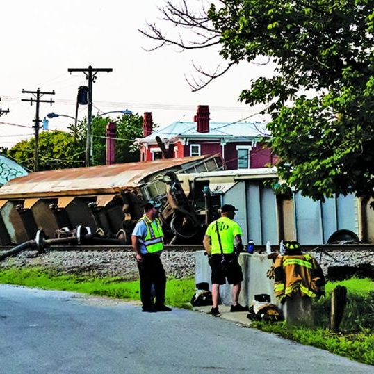 The Harrodsburg Herald/Robert Moore Railroad crews worked to clear the tracks after a train derailment on Thursday. Authorities are still trying to determine what cased seven cars to capsize.