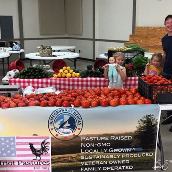 The Harrodsburg Herald/ Jennifer Marsh Tessa, Ashley, Evelyn, Emma, Ashley and Glen Pegher at the Mercer County Farmer's Market selling products from Patriot Pastures last year. The Mercer County Farmers Market opens Saturday, May 5.